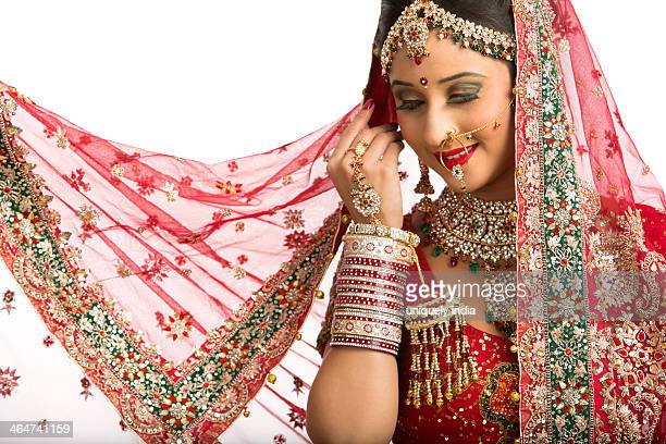Smiling Indian bride in traditional wedding dress