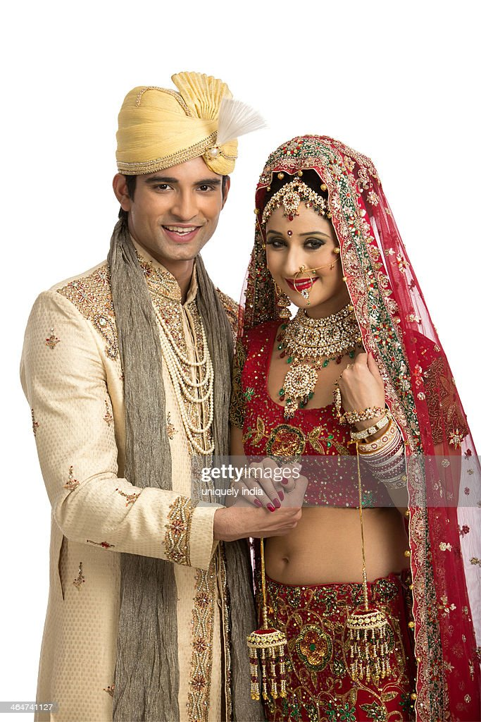 edc08a8743 Smiling Indian Newlywed Couple In Traditional Wedding Dress Stock