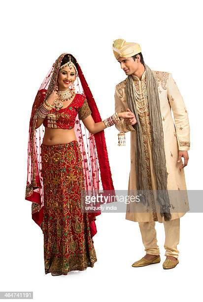 Smiling Indian newlywed couple posing