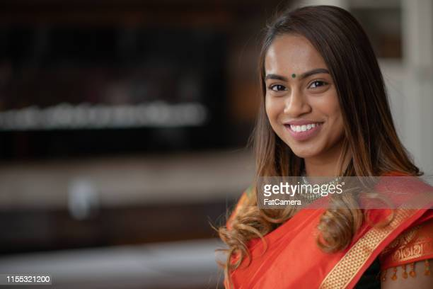 smiling indian woman portrait - bindi stock pictures, royalty-free photos & images