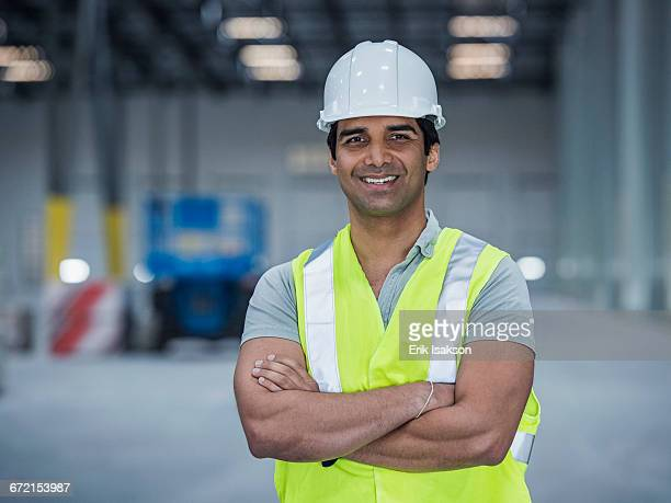 Smiling indian worker in warehouse