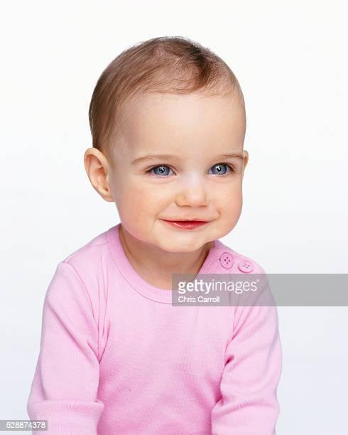 Smiling Infant Wearing Pink