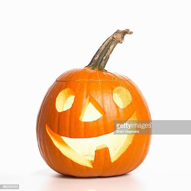 smiling jack-o-lantern - halloween lantern stock photos and pictures