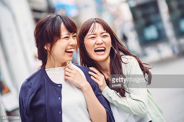 Smiling japanese girl friends outdoors in Tokyo