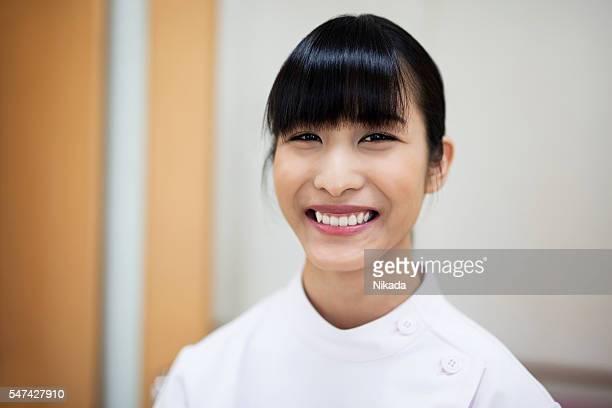 smiling japanese nurse in hospital