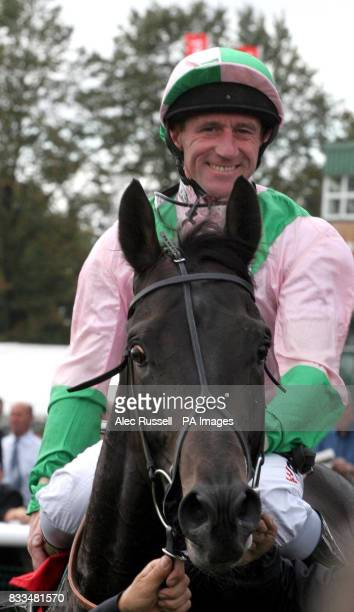 A smiling John Egan comes in after winning the first race on Dubai Dynamo at Doncaster Racecourse