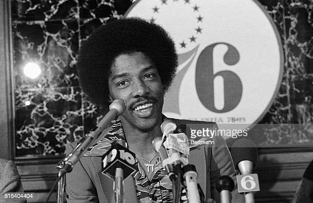 Smiling Julius Erving greets newsmen here 10/21 after he signed a 3.5 million dollar contract with the Philadelphia 76ers. Erving had been playing...