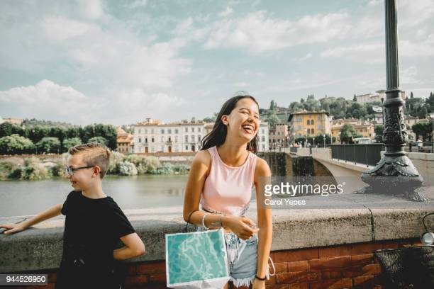 smiling kids visiting florence, italy - florence italy ストックフォトと画像