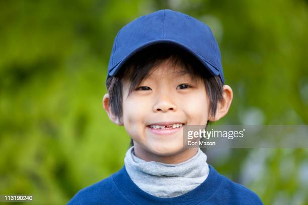 Smiling Korean boy in baseball cap