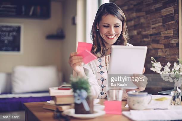 Smiling latin businesswoman working at home