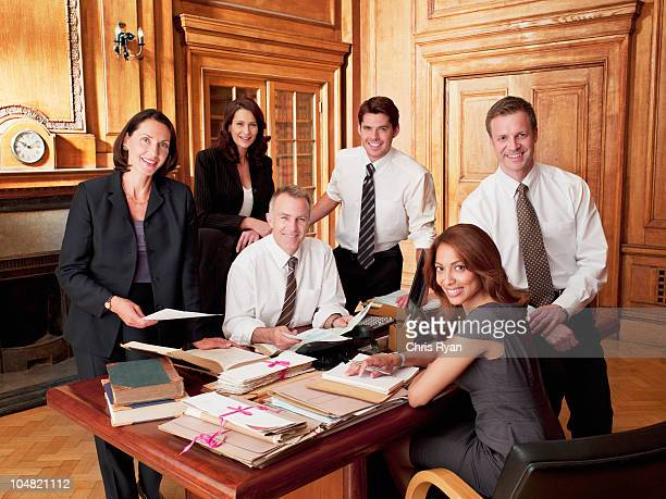 smiling lawyers in office - law stock pictures, royalty-free photos & images