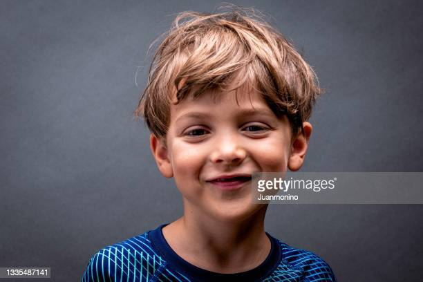 smiling little boy looking at the camera - scandinavian ethnicity stock pictures, royalty-free photos & images