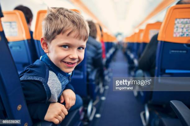 Smiling little boy travelling in plane