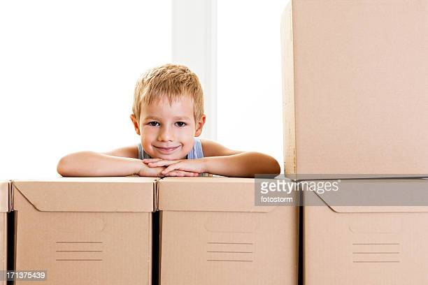 Smiling little boy with boxes
