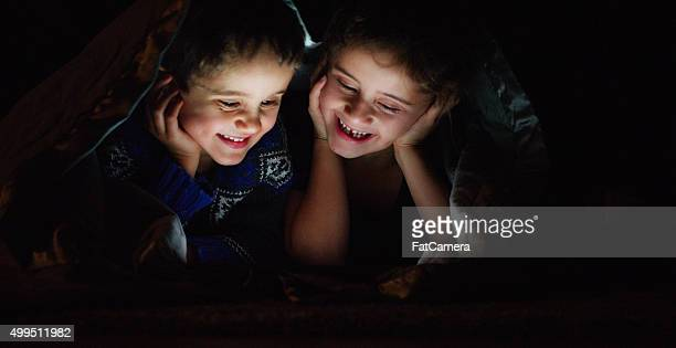 Smiling Little Children Watching a Video