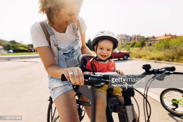 smiling little cycler - bicycle lane stock pictures, royalty-free photos & images