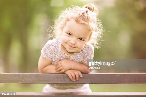 Smiling Little Girl Enjoying Her Time in the Park
