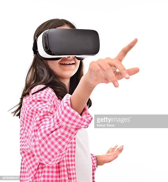 Smiling little girl experience with VR headset