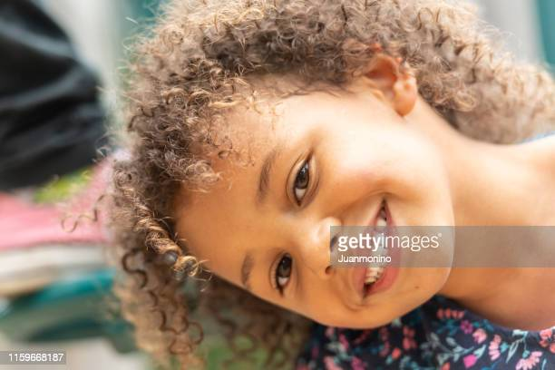 smiling little girl looking at the camera - head cocked stock pictures, royalty-free photos & images