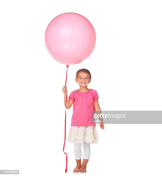Smiling little girl with a balloon isolated on white