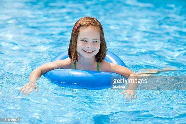 Smiling, Little Girl With Swim Ring, in Swimming Pool