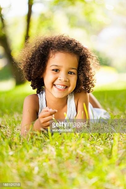 Smiling Little Kid Lying On Grass