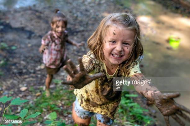 smiling little muddy girl - messing about stock pictures, royalty-free photos & images
