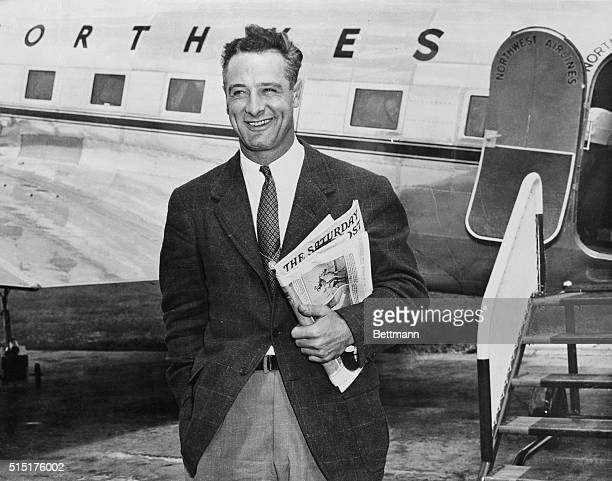 Smiling Lou Gehrig husky first base star of the New York Yankees pictured when he left the airplane that brought him to the Mayo Clinic where he will...