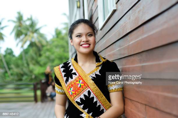 smiling malaysian young woman in dusun lotud traditional cloth sabah borneo native - malaysian culture stock pictures, royalty-free photos & images