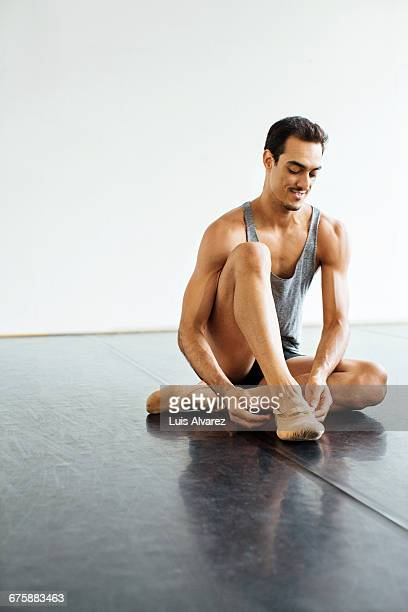 smiling male dancer wearing ballet shoes at studio - ショートパンツ ストックフォトと画像