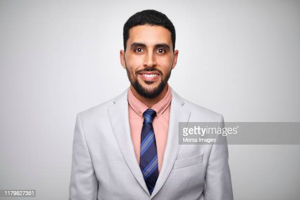 smiling male design professional wearing gray suit - middle east stock pictures, royalty-free photos & images