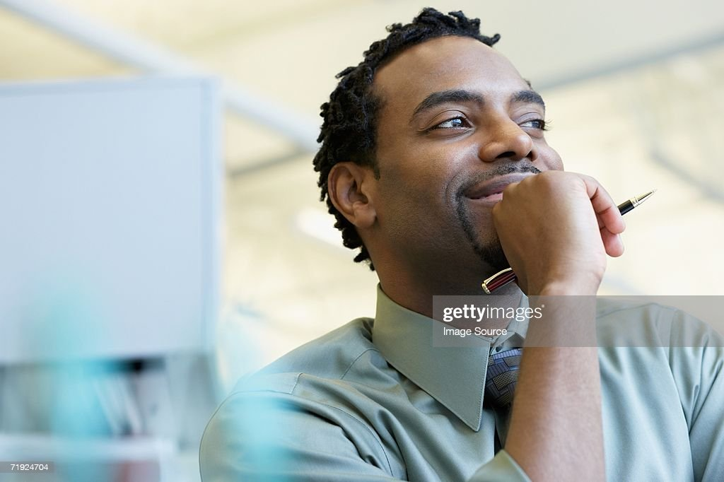 Smiling male office worker : Stock Photo