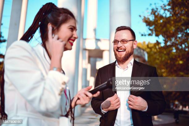 smiling male politician ready to elaborate latest state happenings with female journalist - presidential candidate stock pictures, royalty-free photos & images