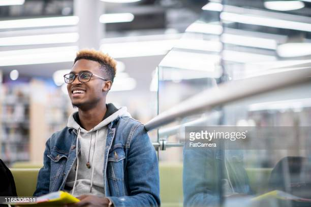smiling male student at school - university student stock pictures, royalty-free photos & images