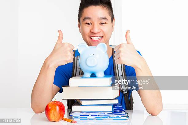Smiling male student with thumbs up