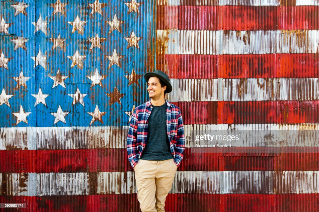 Smiling man against American flag background : Stock Photo