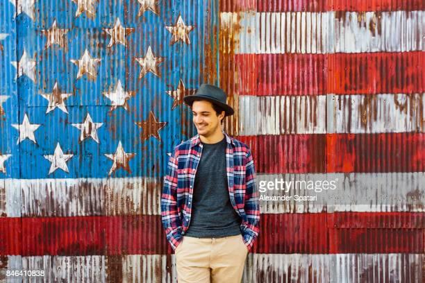 Smiling man against American flag background