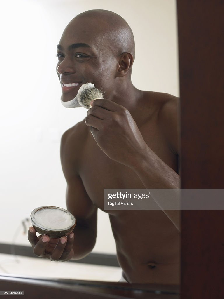 Smiling Man Applying Shaving Foam on His Face : Stock Photo