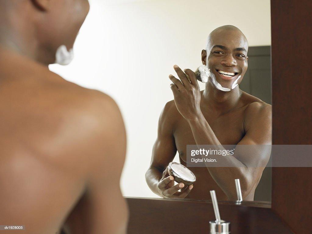 Smiling Man Applying Shaving Foam on His Face : Stock Photo