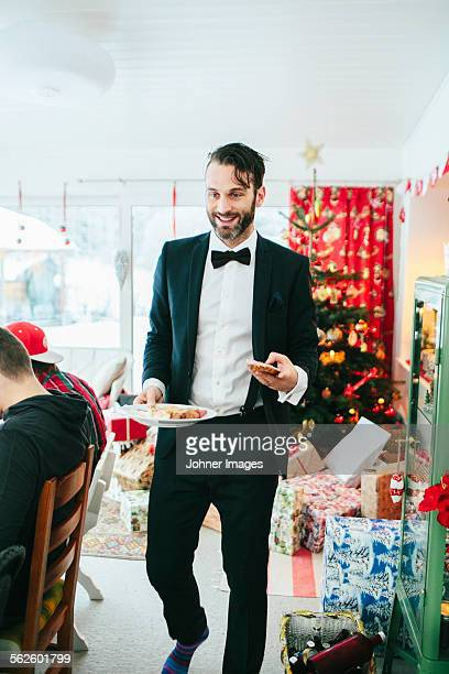 Smiling man at Christmas dinner