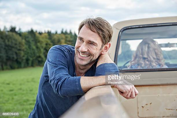 Smiling man at pick up truck