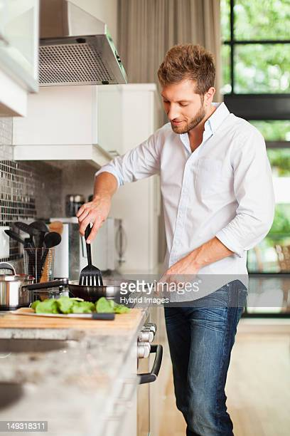 Smiling man cooking in kitchen