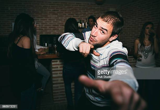 Smiling man dancing in nightclub