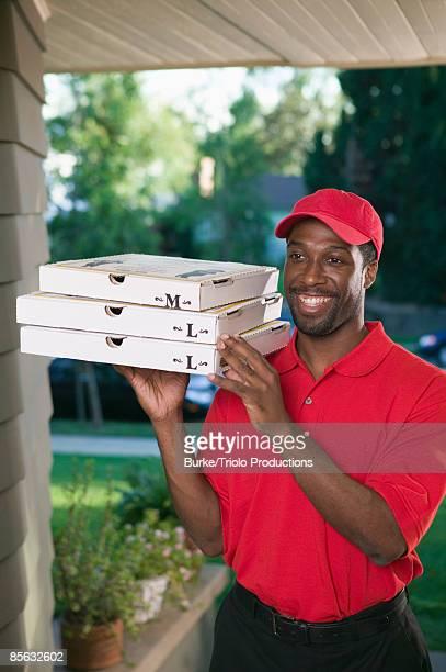 Smiling man delivering pizza