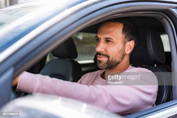 smiling man driving car - driving stock pictures, royalty-free photos & images