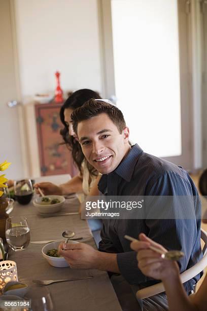 Smiling man eating matzoh ball soup