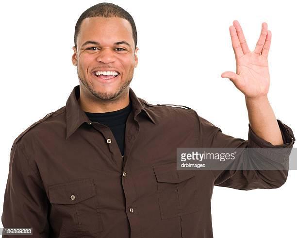Sonriente hombre le saludo vulcano