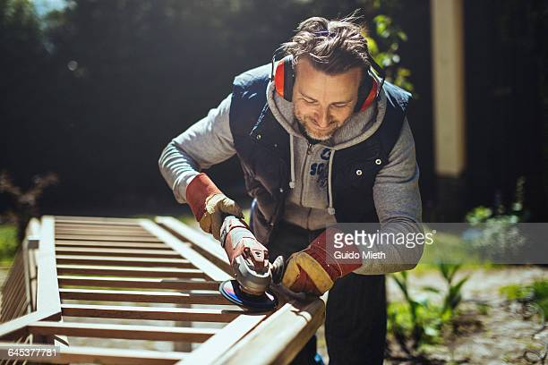 smiling man grinding a handrail. - diy stock pictures, royalty-free photos & images