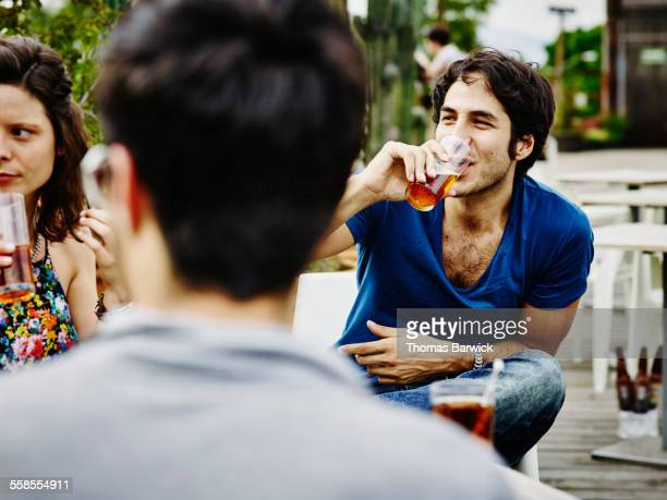 smiling man having drinks with friends - handsome mexican men stock pictures, royalty-free photos & images