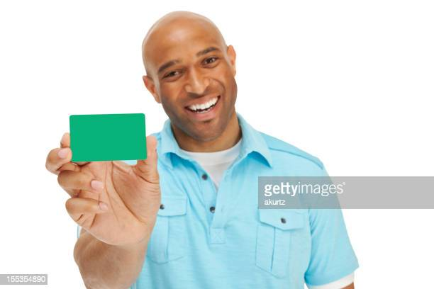 Smiling man holding generic green card isolated on white
